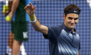 Switzerland's Federer waves after winning his quarter final match against Dimitrov of Bulgaria at the Swiss Indoors ATP tennis tournament in Basel