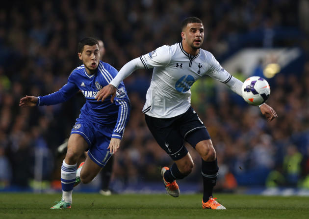 Chelsea's Eden Hazard, left, competes with Tottenham Hotspur's Kyle Walker during their English Premier League soccer match at Stamford Bridge, London, Saturday, March 8, 2014