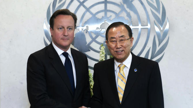 British Prime Minister David Cameron, left, shakes hands with U.N. Secretary General Ban Ki-moon before their meeting, at United Nations headquarters Wednesday, May 15, 2013. (AP Photo/Mark Garten, United Nations)