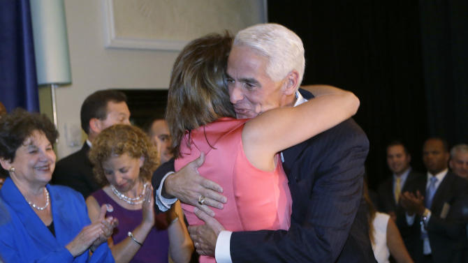 Former Republican Gov. Charlie Crist, right, hugs his running mate Annette Taddeo before speaking to supporters at a victory party after Florida's primary election, Tuesday, Aug. 26, 2014 in Fort Lauderdale, Fla. Crist won the Democratic primary to challenge Republican Gov. Rick Scott marking another step in an unlikely political comeback four years after leaving the GOP. Crist is the first person in Florida to win the nomination for governor as a Republican and a Democrat. (AP Photo/Wilfredo Lee)