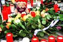 Tributes are laid in front of the headquarters of German airline Germanwings in Cologne