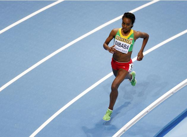 Ethiopia's Genzebe Dibaba runs in her 3000m heat during the Athletics World Indoor Championships in Sopot, Poland, Friday, March 7, 2014