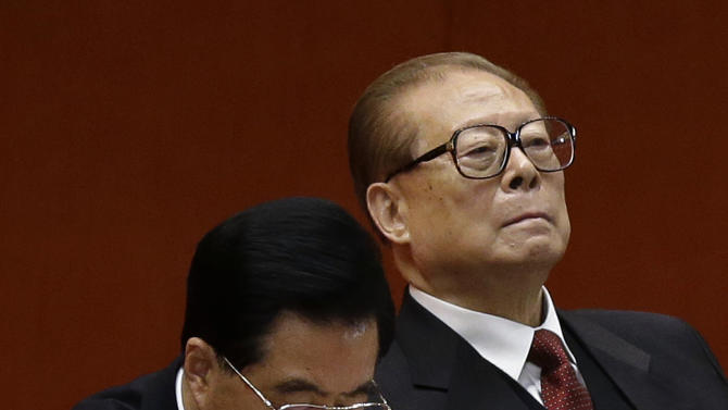 Former Chinese President Jiang Zemin, right, and Chinese President Hu Jintao attend the closing ceremony of the 18th Communist Party Congress held at the Great Hall of the People in Beijing Wednesday, Nov. 14, 2012. (AP Photo/Vincent Yu)