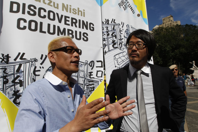 "Japanese artist Tatzu Nishi, left, speaks to reporters with the help of translator Kasuke Fujitaka during a media preview of ""Discovering Columbus,""  Wednesday, Sept. 19, 2012 in New York.  The 810-sq"