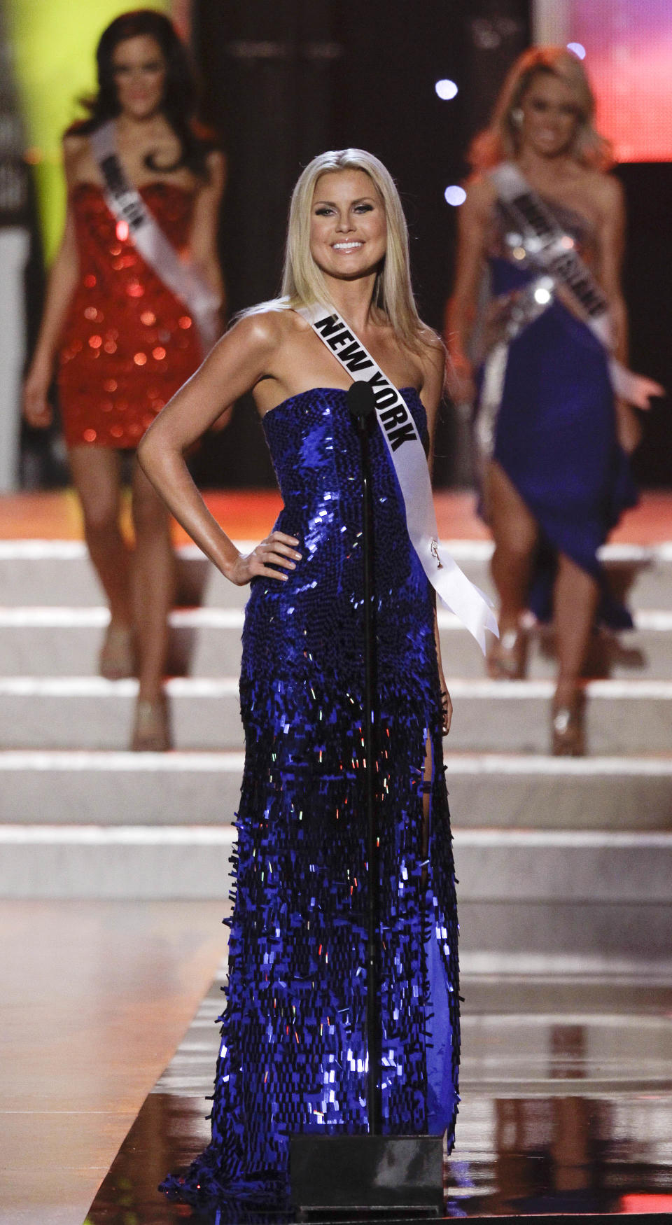 Amber Marie Collins, Miss New York, introduces herself at the start of the Miss USA pageant, Sunday, June 19, 2011, in Las Vegas.  (AP Photo/Julie Jacobson)