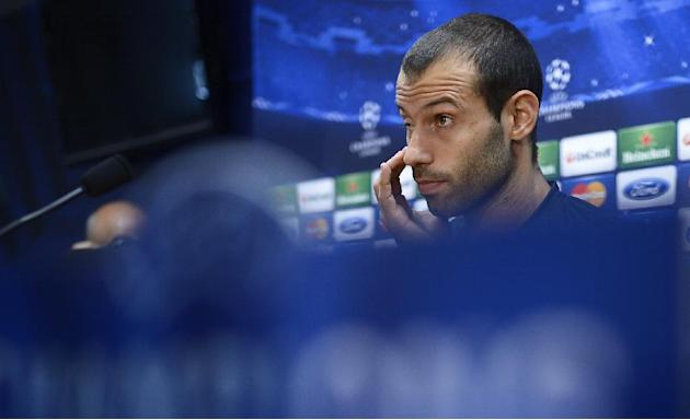 FC Barcelona's Javier Mascherano, from Argentina, listens during a news conference at the Sports Center FC Barcelona Joan Gamper in San Joan Despi, Spain, Tuesday, March 11, 2014. FC Barcelona wil