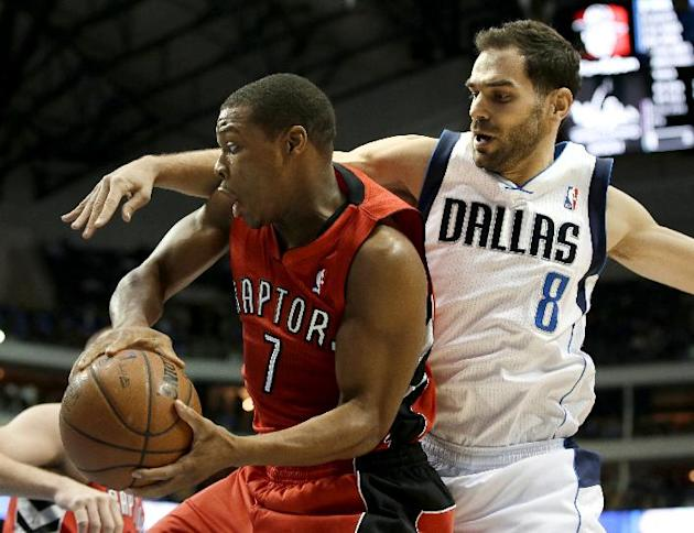 Toronto Raptors' Kyle Lowry (7) is fouled by Dallas Mavericks' Jose Calderon (8), of Spain, in the first half of an NBA basketball game, Friday, Dec. 20, 2013, in Dallas