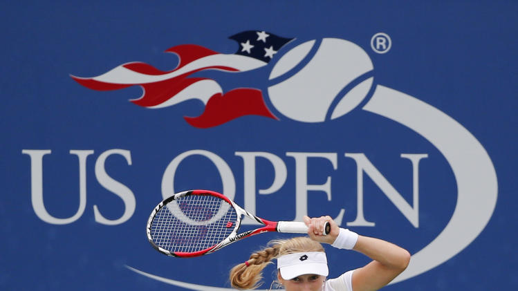 Ekaterina Makarova, of Russia, returns a shot against Zarina Diyas, of Kazakhstan, during the third round of the 2014 U.S. Open tennis tournament, Saturday, Aug. 30, 2014, in New York. (AP Photo/Elise Amendola)