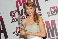 Taylor Swift poses with the Performer of the Year award at the 45th annual CMA Awards at the Bridgestone Arena in Nashville, Tennessee on November 9, 2011  -- Getty Images