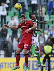 Mallorca's forward Tomer Hemed (L) jumps with Betis' defender Mario during the Spanish league football match at the Benito Villamarin stadium in Sevilla on December 22, 2012. Mallorca surprised an in-form Real Betis with a 2-1 away win that denied the side from Seville a chance to move into fourth position