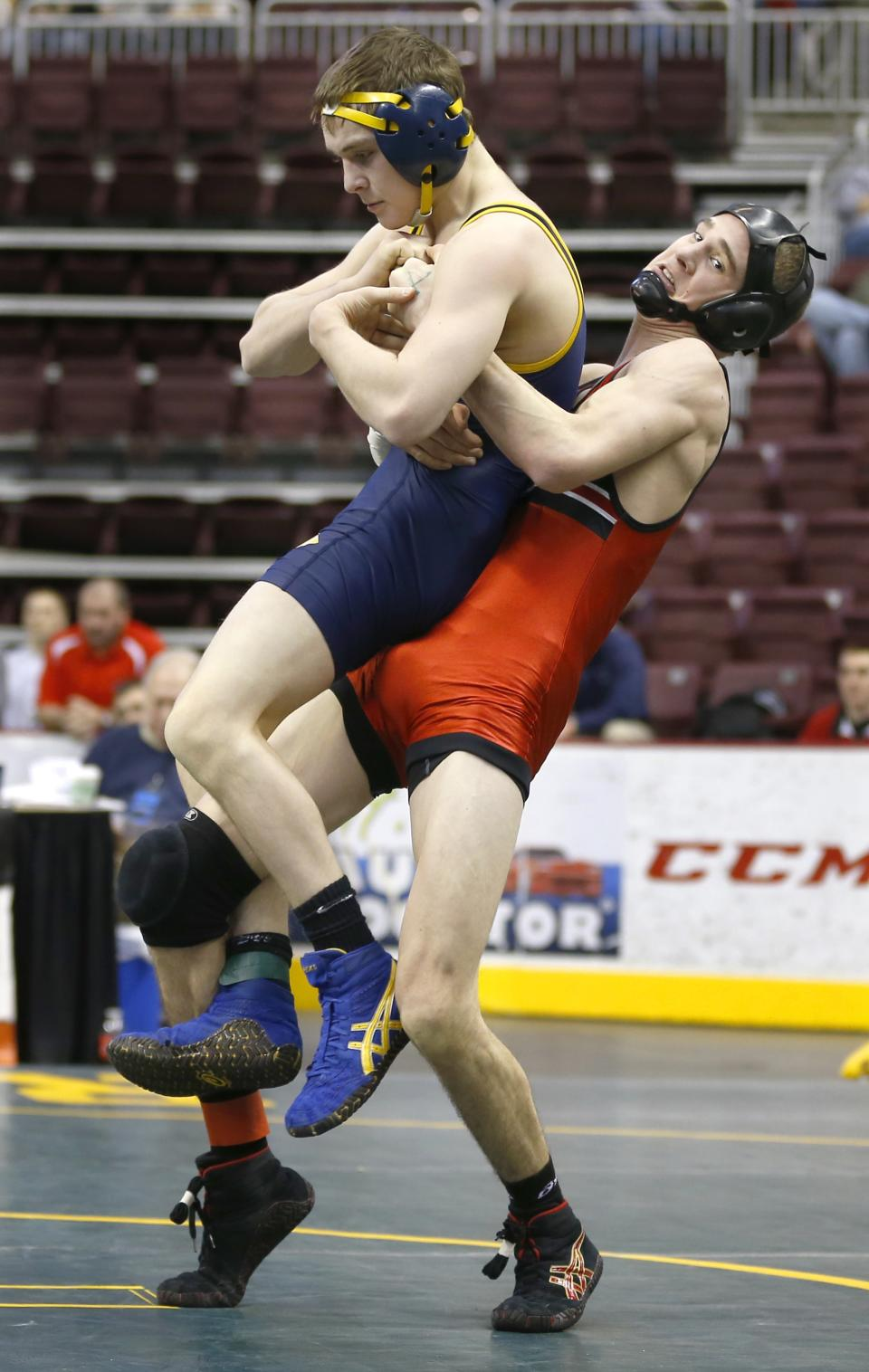 Northwestern's Matt Wheeler, right, tries to take down Saegertown's Tyler Vath in a 120-pound match at the PIAA Class AA high school wrestling championships on Friday, March 8, 2013, in Hershey, Pa. (AP Photo/Keith Srakocic)