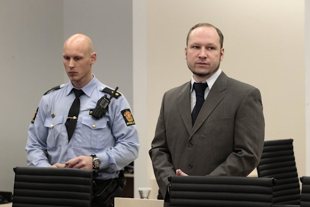 "Mass killer Anders Behring Breivik, right, stands in the courtroom in Oslo, Norway Thursday April 26, 2012. Breivik has slammed a psychiatric report that declared him insane, insisting it was based on ""evil fabrications"" meant to portray him as irrational and unintelligent. (AP Photo/Hakon Mosvold Larsen/NTB Scanpix, Pool)"