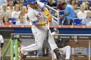 New York Mets hitter Yoenis Cespedes hits a two-RBI double in the fifth inning against the Miami Marlins during a baseball game in Miami, Monday Aug. 3, 2015. (AP Photo/Joe Skipper)