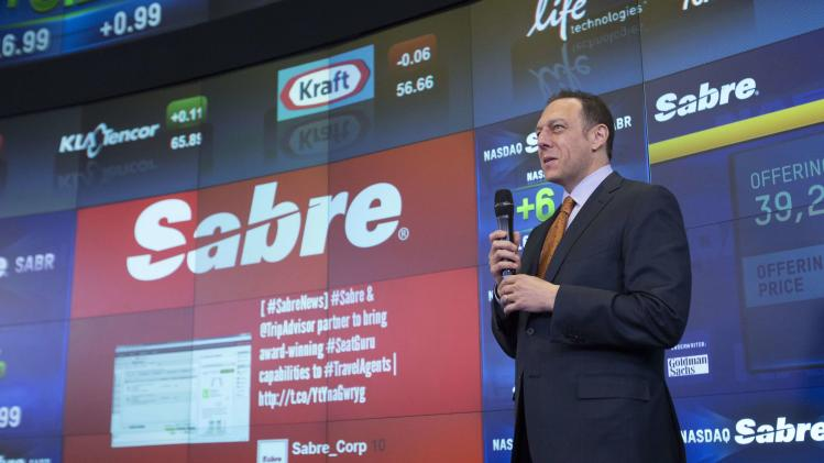 Tom Klein, Chief Executive Officer and President of Sabre Corporation speaks following the opening of trading at the NASDAQ MarketSite in Times Square in celebration of Sabre Corporation's initial public offering (IPO) on The NASDAQ Stock Market in New Yor