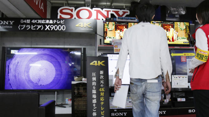 A customer visits a Tokyo electronics store to check out Sony's Bravia 4K flat-panel TVs in Tokyo, Thursday, May 9, 2013. Sony Corp. is back in the black for the fiscal fourth quarter, recording a 93.9 billion yen ($948 million) profit, with big help from a weaker yen that boosts overseas earnings. (AP Photo/Koji Sasahara)