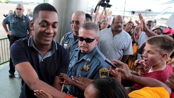 """""""American Idol"""" finalist Joshua Ledet of Westlake, La., is greeted by fans after his arrival from Los Angeles at Chennault International Airport in Lake Charles on Friday, May 11, 2012. Ledet, the 20-year-old top-three finalist on Fox's TV singing competition will be honored with a parade in his home town on Saturday, May 12, 2012, and a pep rally in Burton Coliseum in Lake Charles that evening. (AP Photo/K Wink, LAKE CHARLES AMERICAN PRESS)"""