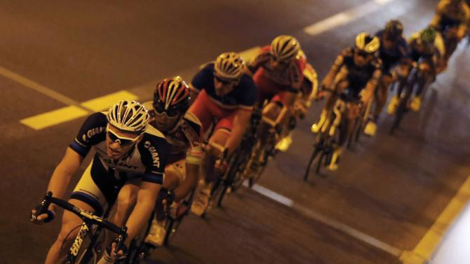 Giant-Shimano team rider Kittel of Germany cycles through a tunnel during Point Race 2 at the Tour de France Saitama Criterium cycling race in Saitama