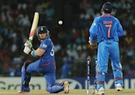 England's Jonathan Bairstow (L) gets dismissed by India spinner Piyush Chawla (not pictured) as wicketkeeper Mahendra Singh Dhoni (R) looks on during their World Twenty20 match on September 23
