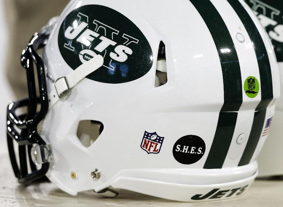 A decal honoring the victims of the Sandy Hook Elementary School shootings in Newtown, Conn., appears on a New York Jets helmet before an NFL football game between the Jets and the Tennessee Titans, Monday, Dec. 17, 2012, in Nashville, Tenn. (AP Photo/Wade Payne)