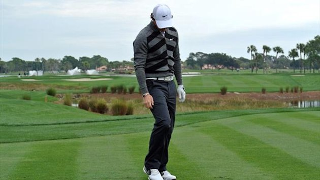Rory McIlroy of Northern Ireland looks at his club on the 18th hole of the Honda Classic (AFP)