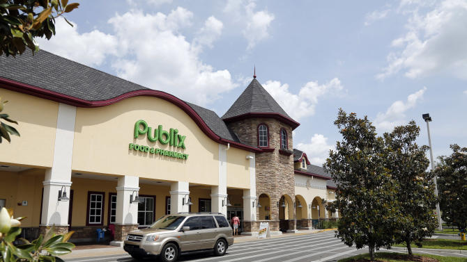 A vehicle passes the front of the Publix supermarket in Zephyrhills, Fla., Sunday, May 19, 2013. The highest Powerball jackpot worth an estimated $590.5 million was sold recently at this Publix supermarket. (AP Photo/Scott Iskowitz)