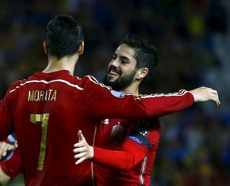 Spain's Morata is congratulated by Isco after scoring against Ukraine during their Euro 2016 qualifier in Seville