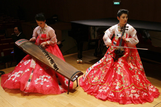 Musicians of North Korea's Unhasu Orchestra with traditional instruments perform during the last rehearsal directed by South Korean conductor Chung Myung-whun in Paris, Wednesday, March 14, 2012.  Chu