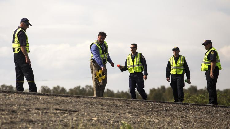NTSB and California Highway Patrol investigators take measurements on Interstate 5 in Orland, California