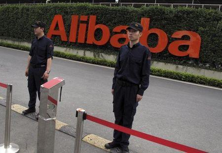 Guards stand near an entrance to Alibaba's headquarters in Hangzhou