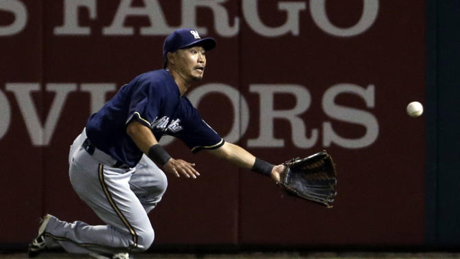 FILE - In this Sept. 10, 2013, file photo, Milwaukee Brewers right fielder Norichika Aoki catches a ball hit by St. Louis Cardinals' David Freese for the out during the fifth inning of a baseball game in St. Louis. The Brewers have traded Aoki to the Kansas City Royals on Thursday, Dec. 5, 2013, for left-handed pitcher Will Smith. The move likely means that Ryan Braun will move from left to right field in 2014 for the Brewers. (AP Photo/Jeff Roberson, File)