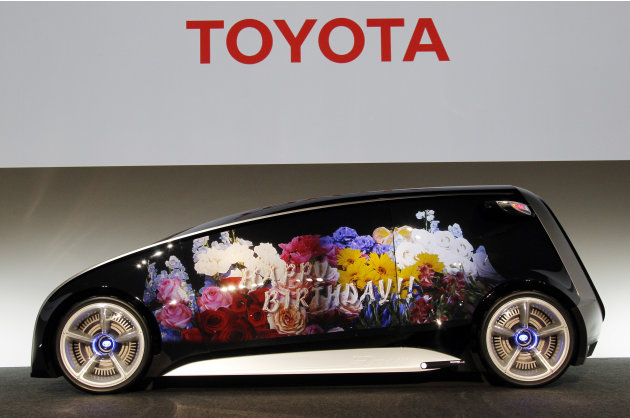 A Toyota Fun-Vii with its whole body can be used as a display space is shown in Tokyo Monday, Nov. 28, 2011. Toyota Motor Corp. unveiled the futuristic concept car resembling a giant smartphone to dem