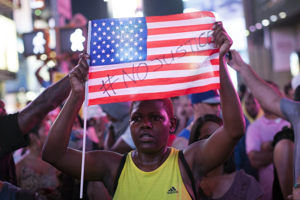 Protesters rally in response to the acquittal of George Zimmerman in the Trayvon Martin trial in Times Square in New York