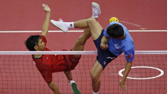 Japan's Toshitaka Naito strikes the ball against South Korea during their men's team sepaktakraw game at the 17th Asian Games in Incheon
