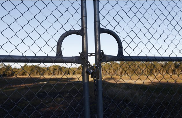 A padlock is seen on a fence on the land where a a full-size replica of Beijing's Forbidden City will be built, in the Wyong region near Sydney