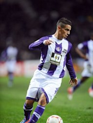Toulouse's forward Wissam Ben Yedder runs to score a goal during the French L1 football match against Brest at the municipal stadium in Toulouse. Toulouse won 3-1