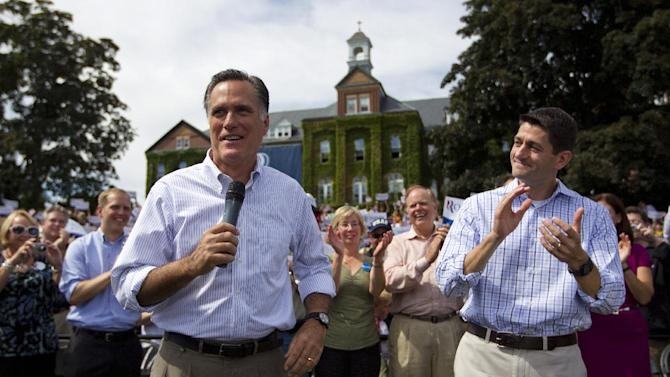 Republican vice presidential candidate, Rep. Paul Ryan, R-Wis. applauds at right as Republican presidential candidate, former Massachusetts Gov. Mitt Romney speaks during a campaign rally, Monday, Aug. 20, 2012, in Manchester N.H.  (AP Photo/Evan Vucci)