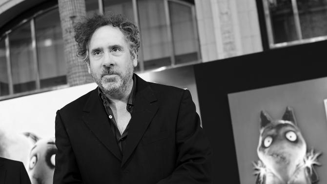 """FILE - In this Sept. 24, 2012 publicity file photo provided by Disney, director Tim Burton arrives at the premiere of Disney's stop-motion animated full length black and white film """"Frankenweenie,"""" directed by Tim Burton in Los Angeles. Burton's boy-and-his-dead-dog tale """"Frankenweenie"""" is Hollywood's latest resurrection of stop-motion animation, a century-old style that still creeps on to the big-screen now and then in an age of computer-generated cartoon blockbusters. (AP Photo/Disney, Jordan Strauss, File)"""