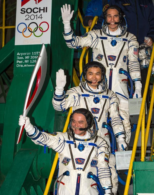 Mikhail Tyurin of Roscosmos (Bottom), Flight Engineer Koichi Wakata and Flight Engineer Rick Mastracchio of NASA prior to boarding the Soyuz TMA-11M rocket for launch, November 7, 2013