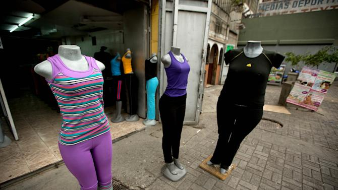 Mannequins stand at a store that sells clothing for over weight people in downtown Caracas, Venezuela, Tuesday, Aug. 26, 2014. The Venezuelan government has launched a public relations campaign to halt a steady rise in obesity that, if left unchecked, threatens to lead to a costly, public health crisis. (AP Photo/Fernando Llano)