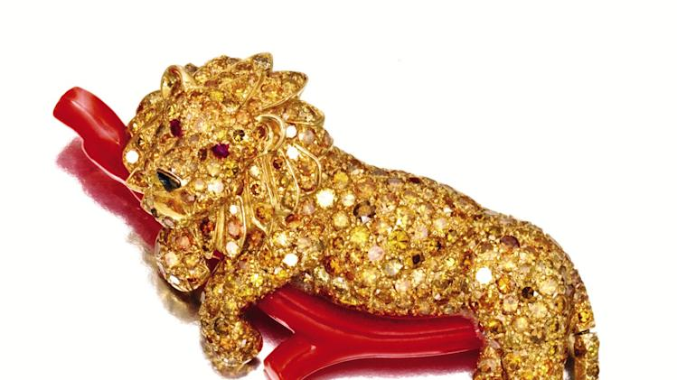 FILE - This undated file photo provided by Sotheby's shows a gold, a colored diamond, coral and ruby lion brooch that belonged to the late philanthropist Brooke Astor. The piece will be sold at an auction in New York of the late philanthropist's personal items which will include some 900 items to be offered Sept. 24-25 from Astor's Park Avenue duplex and her stone manor in Westchester. (AP Photo/Sotheby's, File)