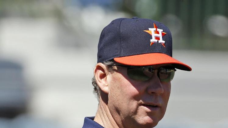 Houston Astros owner Jim Crane stands on the field before in a spring exhibition baseball game against the New York Yankees, Saturday, March 8, 2014, in Kissimmee, Fla. (AP Photo/Alex Brandon)