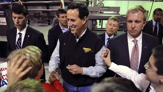 Republican presidential candidate former Pennsylvania Sen. Rick Santorum, speaks to supporters at Hawkeye Industries in Tupelo, Miss., Wednesday, March 7, 2012. (AP Photo/Alex Gilbert)