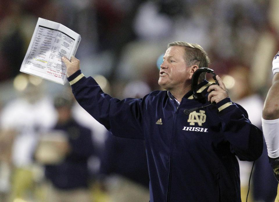 Notre Dame head coach Brian Kelly shouts from the sidelines in the second quarter of an NCAA college football game against Oklahoma in Norman, Okla., Saturday, Oct. 27, 2012. (AP Photo/Sue Ogrocki)