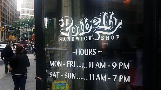 People walk past a Potbelly Sandwich shop in New York, on Friday, Sept. 27, 2013. The Empire State Building, Re/Max , the Burlington Coat factory, and the sandwich chain Potbelly are among the companies going public next week. (AP Photo/Tali Arbel)