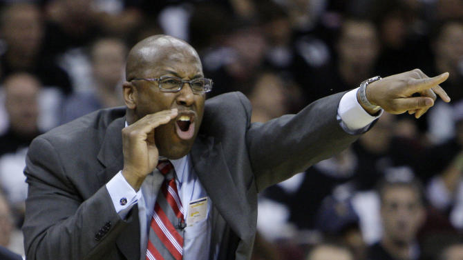 FILE - In this May 3, 2010 file photo, Cleveland Cavaliers coach Mike Brown screams at his team in the third quarter of Game 2 against the Boston Celtics in the second round of an NBA basketball playoff series in Cleveland. Cleveland officially re-hired Brown on Wednesday, April 24, 2013, bringing back a coach who guided them to five straight playoff appearances and their only trip to the NBA Finals before he was fired following the 2010 season. (AP Photo/Mark Duncan, File)