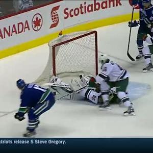 Darcy Kuemper sprawls out to rob Kesler