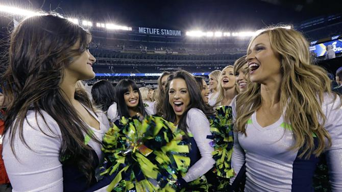Seattle Seahawks cheerleaders celebrate after the NFL Super Bowl XLVIII football game against the Denver Broncos Sunday, Feb. 2, 2014, in East Rutherford, N.J. The Seahawks won 43-8. (AP Photo/Julio Cortez)