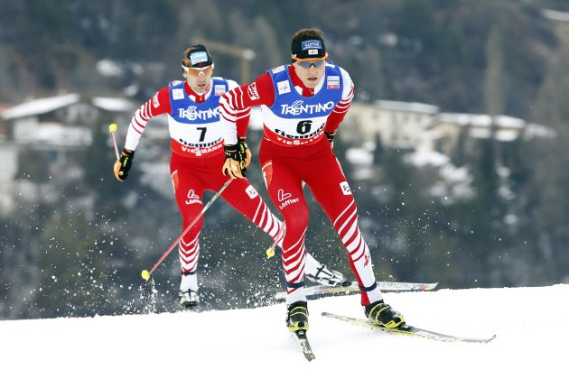 Gruber and Denifl of Austria compete in the Nordic Combined men's Individual Gundersen 10km competition at the Nordic Ski World Championships in Val di Fiemme