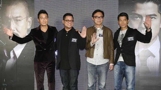 """In this photo taken on Monday, Nov. 12, 2012, from left, Hong Kong actor Tony Leung Ka Fai,  directors Lok Man Leung, Sunny Luk, and actor Aaron Kwok pose for the media during a promotional event for their new film """"Cold War"""" in Taipei, Taiwan. (AP Photo/Chiang Ying-ying)"""