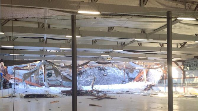 This photo provided by the Canton Police Department and taken by Chief Ken Berkowitz shows the rear portion of the roof that collapsed at the Metropolis Skating Rink on Saturday, Feb. 28, 2015 in Canton, Mass.  Canton Police  said the rear portion of the roof began to fail as a Norwood youth hockey team was inside but they were able to get out along with parents and rink workers. All are safe and accounted for. (AP Photo/Canton Police Department, Chief Ken Berkowitz)